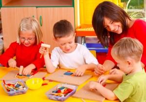 preschoolers learning with teacher