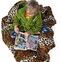 high angle of a boy reading comic book